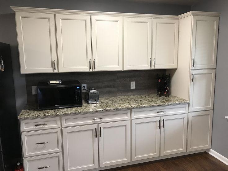White lowes cabinets with grey vinyl flooring for backsplash