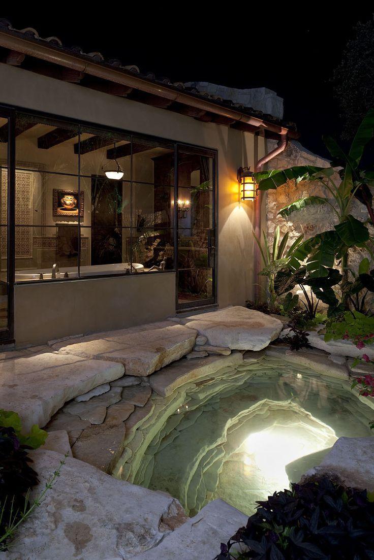Mediterranean style outdoor cushion rock patio umbrella hot tub patio - Soothing Natural Stone Hot Tub In Backyard Mediterranean Grotto