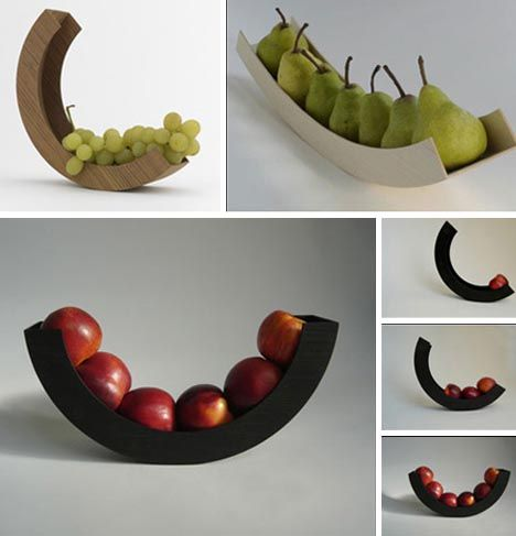 This nifty set of wood, metal and black-painted plastic half-bowls – also by the artist Helena Schepens – does not have quite the same moves but is still quite dynamic. From tiny grapes to sizable pears and appleas, each piece of fruit added to or subtracted from the mix changes the angle of the centerpiece.