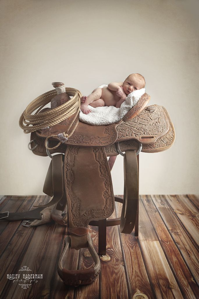love this newborn pose on his daddy's saddle....Newborn Western Photography By Hailey Haberman Photography
