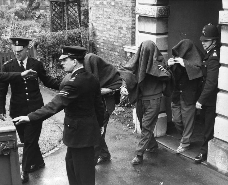 The scene of the Great Train Robbery: the largest train heist in Britain's history.8 August 1963   Three of the suspects arrested in connection with the Great Train Robbery are photographed leaving Linslade court with blankets over their heads.1963
