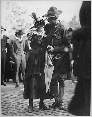 A soldier boy of the 71st Regiment Infantry, New York National Guard, saying goodbye to his sweetheart as his regiment leaves for Camp Wadsworth, Spartanburg, SC, where the New York Division trained for service. International Film Service, 1917.