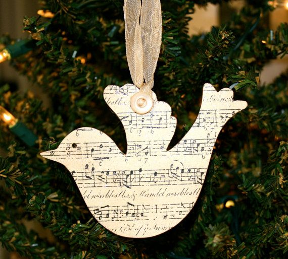 Dove ornament made of 1/8 wood covered with sheet music and silver glitter mist. These sheet music ornaments measure 3 x 4 and hang from