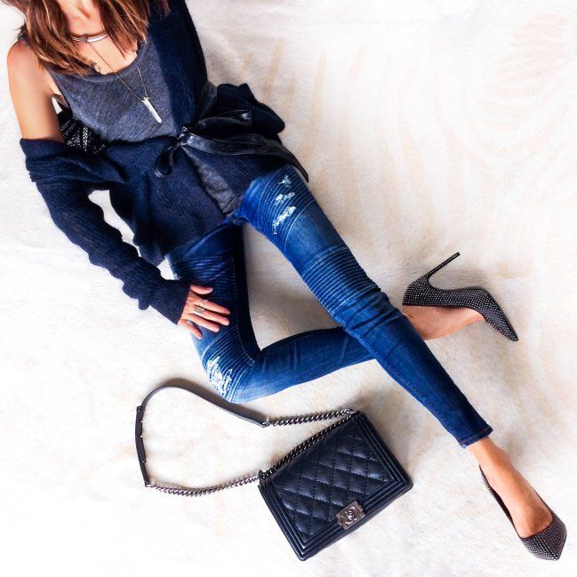 Off the shoulder sweater with moto jeans.