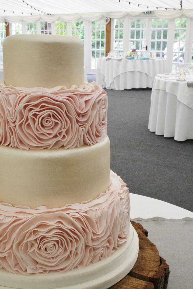 www.sylviaskitchen.co.uk Sylvia's Kitchen | Jenny Four Tier Wedding Cake at Broyle Place, Ringmer, Lewes, East Sussex.  Base and Tier Two finished with blush pink sugar ruffles, Tiers 1 and 3 finished in a soft gold metallic lustre.