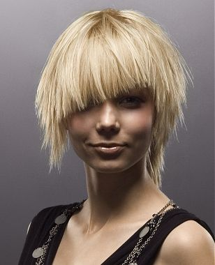 A short blonde straight choppy hairstyle by Paul Stafford
