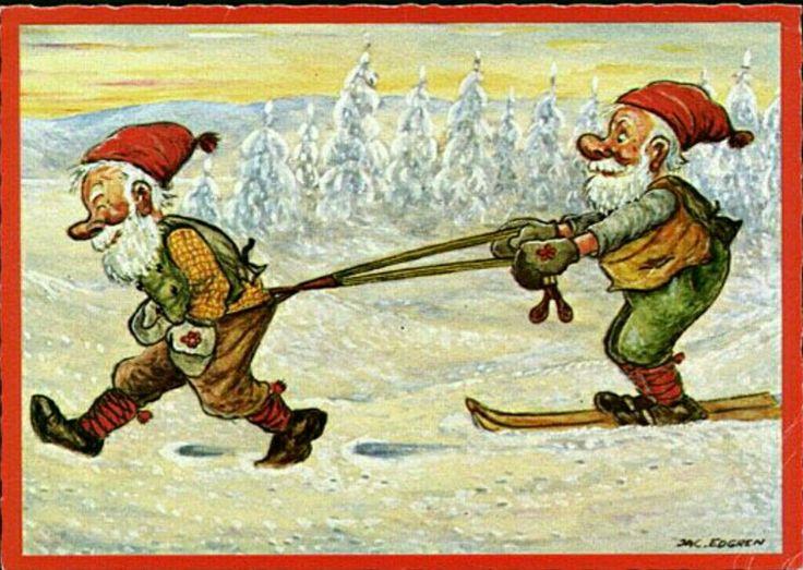 Julkort Jac Edgren tomte drar annan tomte på skidor m byxhängslen