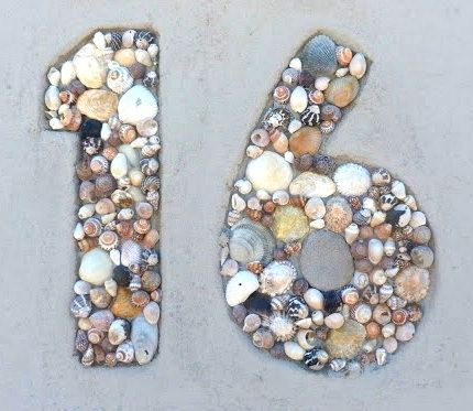 Seashell mosaic house numbers.