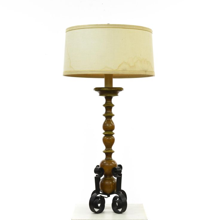 This tall table lamp is featured in a solid wood with a glossy cherry finish. This accent lamp has a curved short lampshade with a turned spindle center and scrolled iron feet. Perfect for lighting up an eclectic living room! #bohemian #decor #lighting #sandiegovintage #vintagefurniture