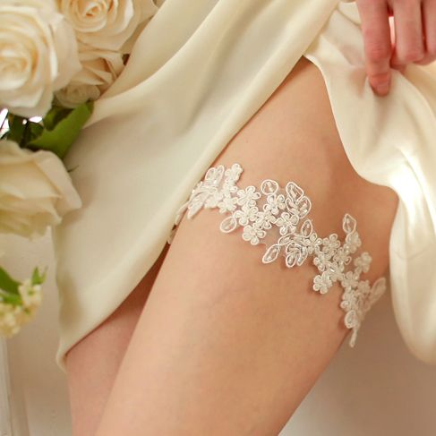 STYLE - #410 CODE:GRT016 Beaded floral lace garter. Floral lace garter features romantic embroidered  and beaded lace, hand-sewn to stretchy elastic band. Very light and comfortable garter for your special day. To order yours contact us at loca@localoca.co.za www.localoca.co.za