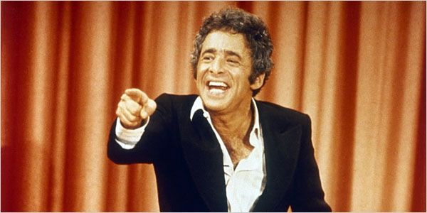 The Gong Show, hosted by Chuck Barris, 1976-1980. Some believe he worked for the CIA.