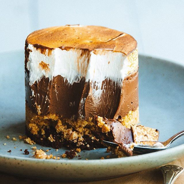 I've been dreaming about this Chocolate Graham Cracker and Toasted Marshmallow Fluff (Meringue) S'mores Cake by @meganleevoigt