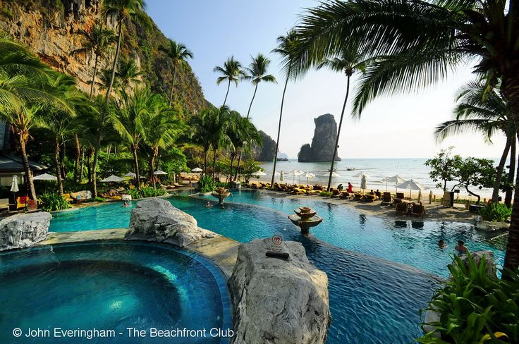 Pool, beach, sea and rock view from Centara Grand Krabi Resort, Thailand.