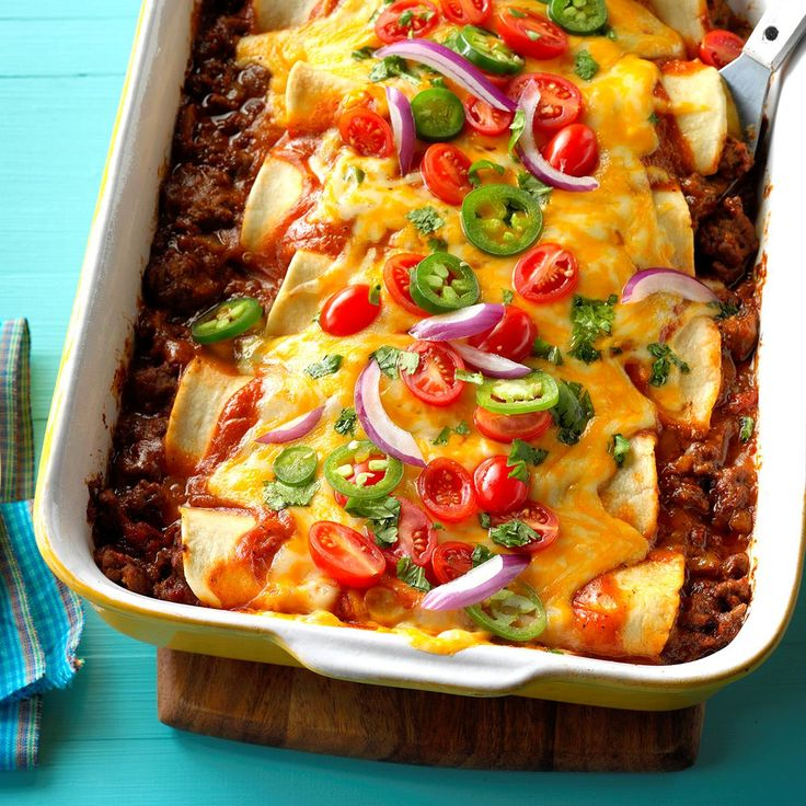 Garlic Beef Enchiladas Recipe -Enchiladas are typically prepared with corn tortillas, but my husband, Jeff, and I prefer flour tortillas. I use them in this saucy casserole that has irresistible home-cooked flavor and a subtle kick. —Jennifer Standridge, Dallas, Georgia