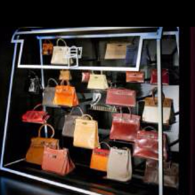 Awesome. Hermes bags displayed in Perspex kelly at London exhibit.