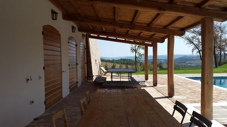 Covered porch outside tasting room of a winery we built in Umbria.