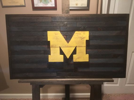 University Of Michigan Wall Hanging!! Perfect for any man cave, office, or rec room. We are currently using 200 year old barn wood to build this