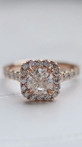 Love this halo diamond ring in rose gold.