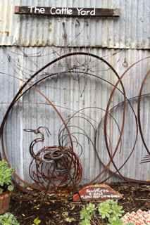 Sculpture garden,with wine barrel rings.