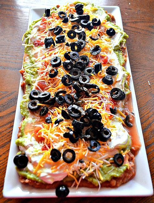 Mexican Layered Dip.  Love the way it looks on this platter!                                                                                                                                                                                 More