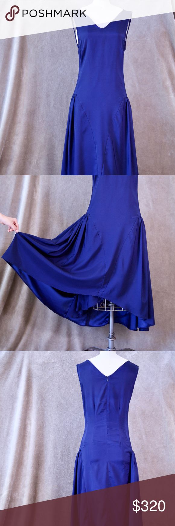 KAROLYN PHO Blue Silk Dress YOU WON'T FIND THIS DRESS ANYWHERE ELSE!!   This gorgeous Karolyn Pho masterpiece is all silk inside and out!  Princess-pleats at the hips give your profile a dramatic flare, and the dress is cut to show off gentle curves with finesse. The front is knee length and the back reaches just above the ankles.  The fit is slim and graceful.  A true treasure!! Karolyn Pho Dresses Asymmetrical