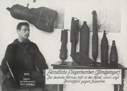 WWI, German soldier with blind shells. -AKG Images