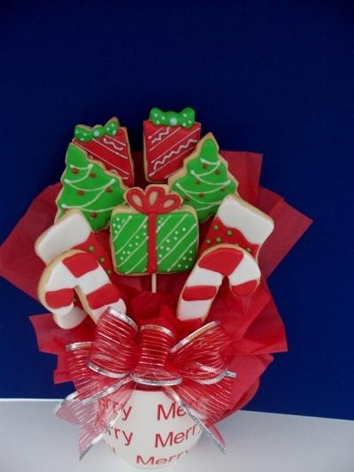 Christmas cookie arrangements--lots of treats on lollipop sticks--in styrofoam ball or mug