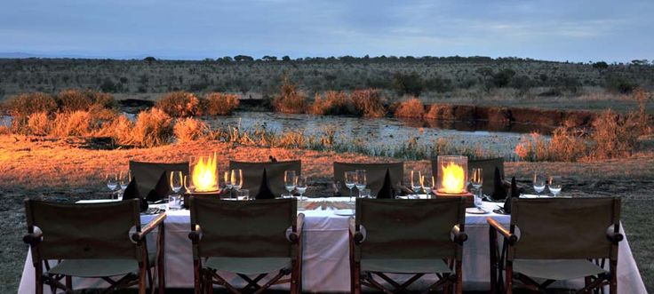 Dining at the waterhole of Savanna Lodge, Sabi Sand Reserve. http://www.pridelodges.com/index.php/game-lodges/luxury/savanna/