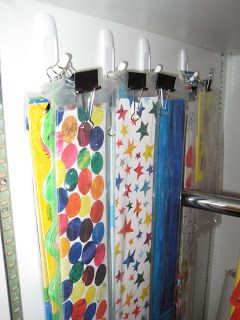 Border storage: Binder Clips + Command(TM) hooks in a long closet - Keeps them nice, straight, and organized!