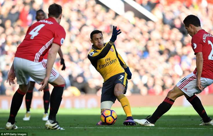 Alexis Sanchez works to manufacture some space under the attention of Ander Herrera and Ph...