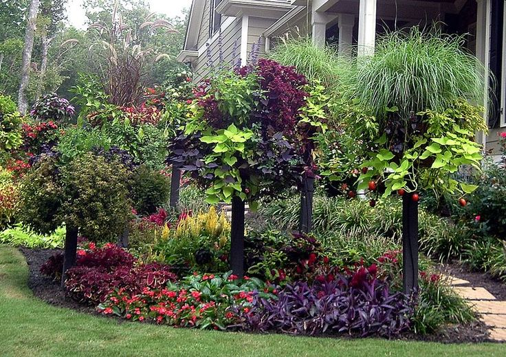 Pamela Crawford's border columns. Love this idea.  Baskets elevated on posts move color to eye level