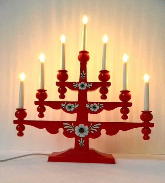 Swedish Christmas candelabra from Gnosjo Konstsmide circa 1980s Swedish folk art Christmas candelabra by famed lighting company Gnosjo Konstsmide. modeled on their much sought after wood candelabras, this cheerful red plastic version may be used indoors or out. our research dates this candelabra to the 1980s. excellent vintage condition. dimensions: height - 20 width - 19 depth - 4