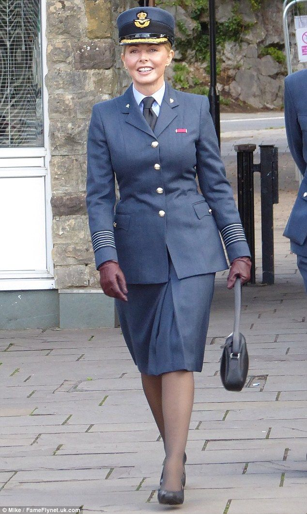 Sharp suited: Carol Vorderman cut a formal figure when she stepped out in Bristol on Friday, where she attended RAF celebrations