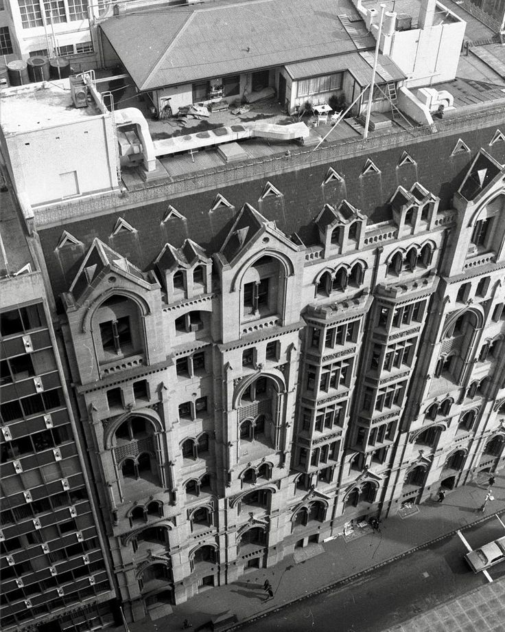 1978. That's the caretakers cottage on top of the A.C. Goode House in Collins St (on the corner of Queen St). Seven floors up amid the smog and pollution, it is home to Arthur Caruana, wife Bernadette, and boys Stephen, 4, and Simon, 7. Arthur is the caretaker of the building and the cottage is part of the job.
