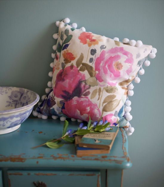 Pom pom trim pillow | At Home in Love. Tuesday Morning store has a ton of Riley Blake Pom Pom trim and I was wondering what the heck would be made using it! This is actually pretty cute!
