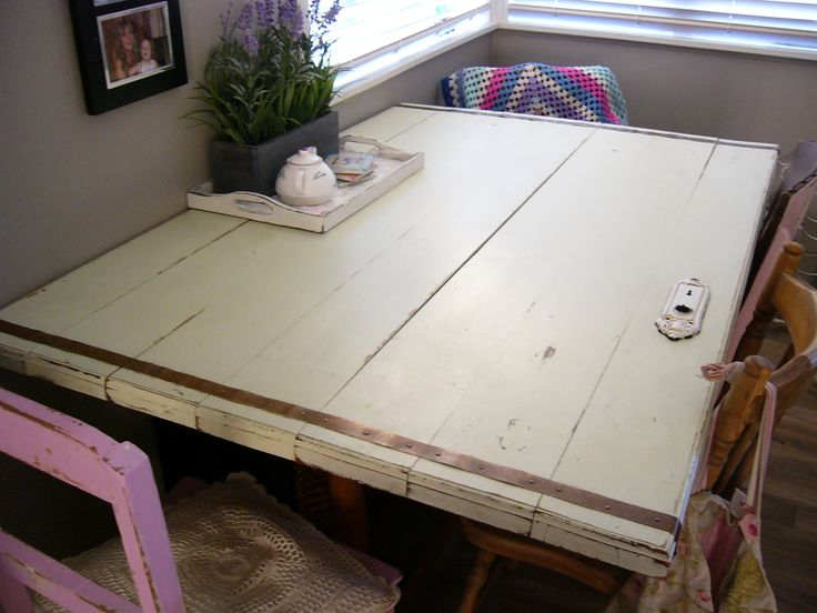 Up-cyled Timber Door is now our Kitchen Table.