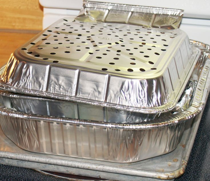 DIY Homemade Smoker for the Oven - Kelli's Kitchen - with instructions showing making ribs in the homemade smoker for the oven