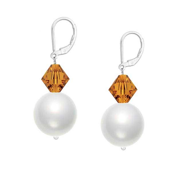 Lustrous 6mm crystal white Swarovski pearls and sparkling 4mm faceted golden topaz crystals hang delicately from a sterling silver leverback earring.