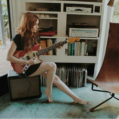 Clary with Simon's guitar