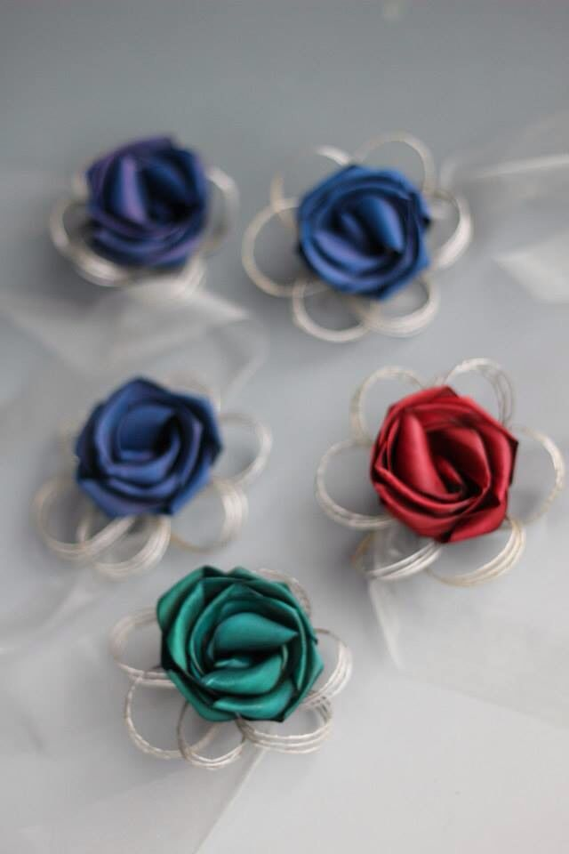 Wrist corsages in mixed colours with organza ribbon. www.flaxation.co.nz