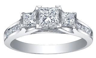 Maple Leaf Diamonds, Three Stone Diamond Collection ~  Pure White™ 18 Karat Canadian Certified Gold diamond ring set with three princess cut Maple Leaf Diamonds Canadian diamonds totaling 1.00ctw.    ML200