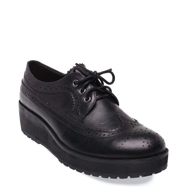 Black Oxford shoe with platform and decorative perforations.