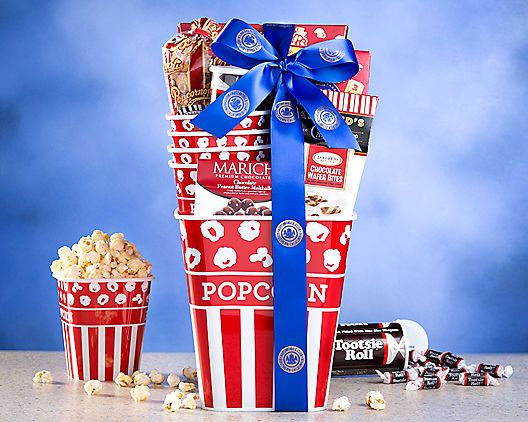 """SC AAA Movie Treats: """"This nostalgic popcorn tub is filled with a collection of movie theater favorites. Hammond's peanut crunch, Marich…"""