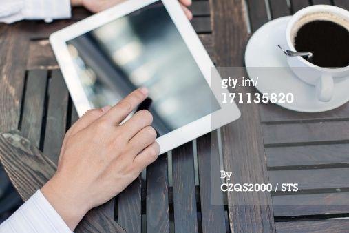 Royalty-free Image: using digital tablet in coffee shop