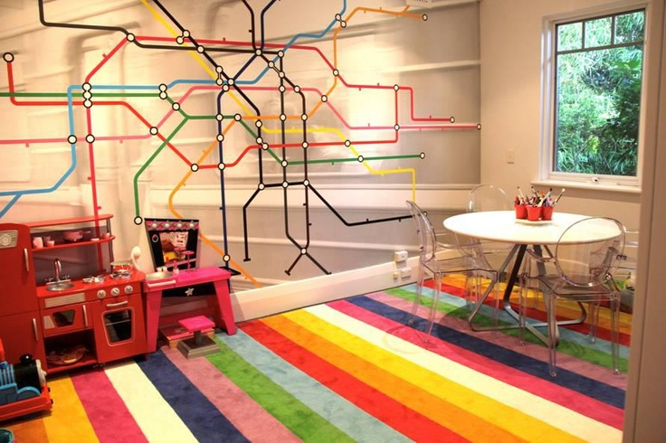 Nicole Rosenberg from Little Liberty has designed this awesome custom stripe rug for a playroom.. How funky!!