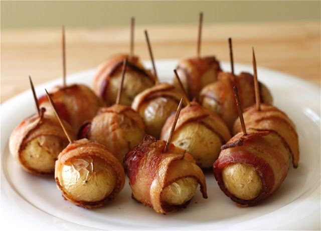 Bacon Wrapped Potatos    INGREDIENTS    8 bacon slices, cut in half crosswise  16 small potatoes    PREPARATION    Preheat oven to 400 degrees. Wrap each bacon piece around a potato and secure with a toothpick. Place in a baking dish and bake until bacon is crisp and potatoes are tender when pierced with a knife, 40 to 50 minutes. Serve warm.