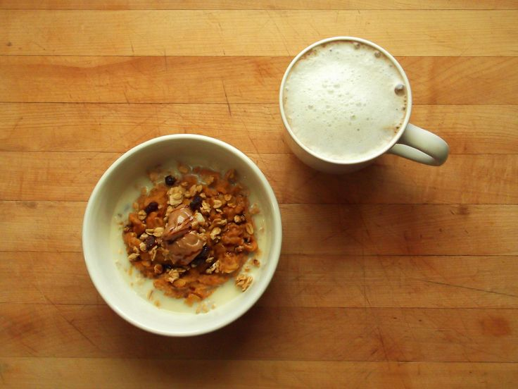 pumpkin pie oatmeal (pumpkin purée, molasses, ground flax seed, pumpkin pie spice, and cinnamon) topped with vanilla soy milk, almond butter...