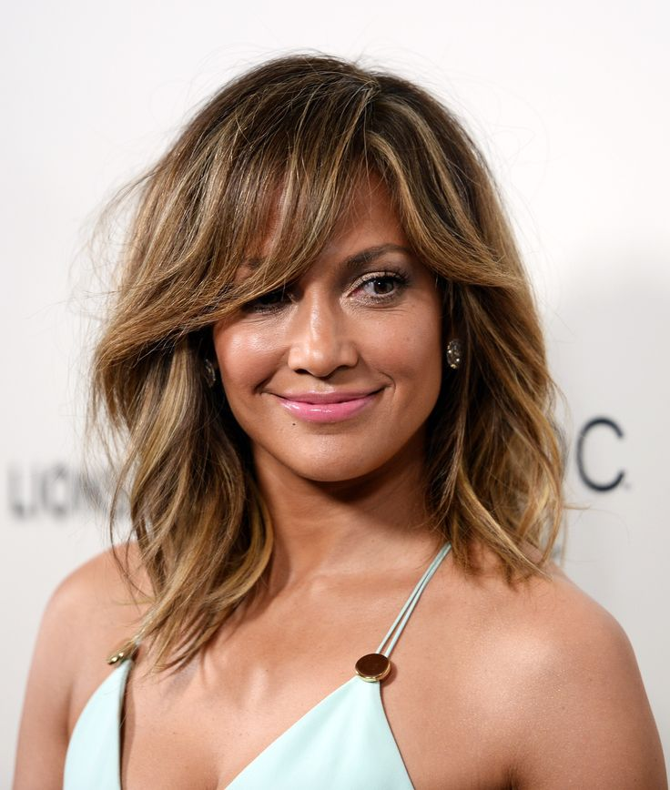 Sideswept long bangs haircut jennifer Lopez The Coolest Spring Haircuts for Every Length and Texture