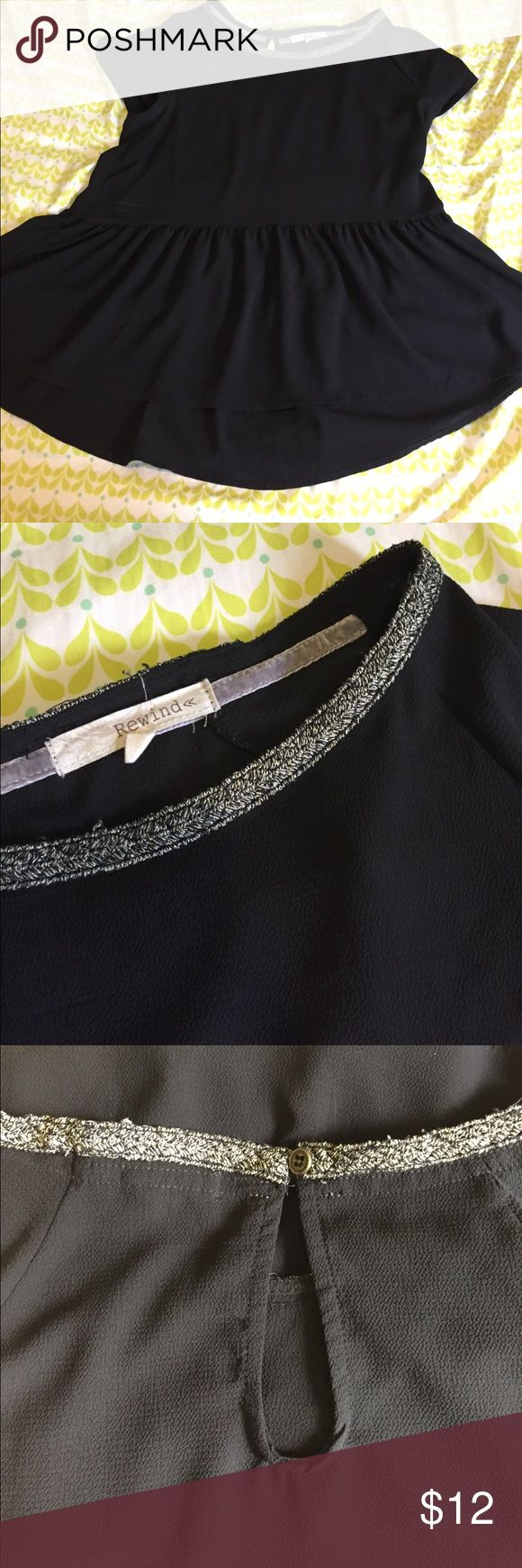 Black flowy peplum Black sheer peplum top. The neckline has a really pretty silver design. Worn once. Could be cute with just a bra or bandeau underneath Rewind Tops Blouses