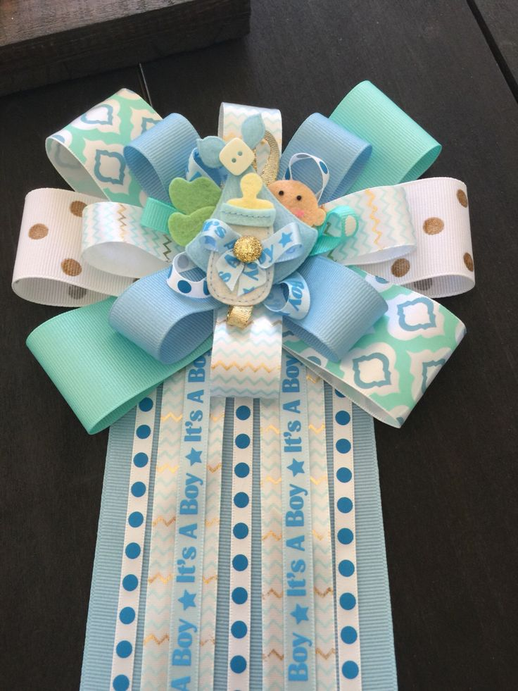 A personal favorite from my Etsy shop https://www.etsy.com/listing/281841248/its-a-boy-baby-shower-mum-corsage-for